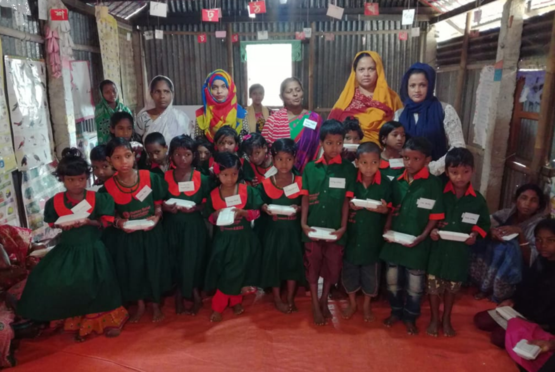 Children receive new uniforms and books at HRF's Tea Estate Schools - Bangladesh
